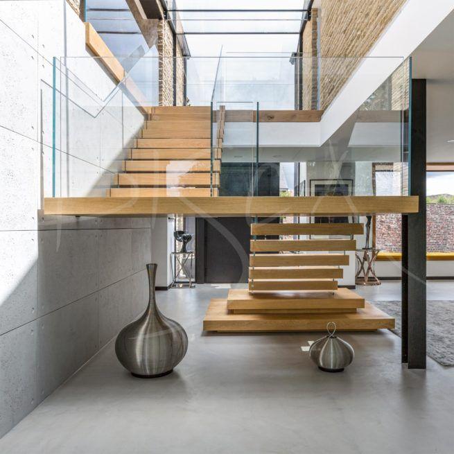 Mẫu thiết kế cầu thang lan can kính cường lực